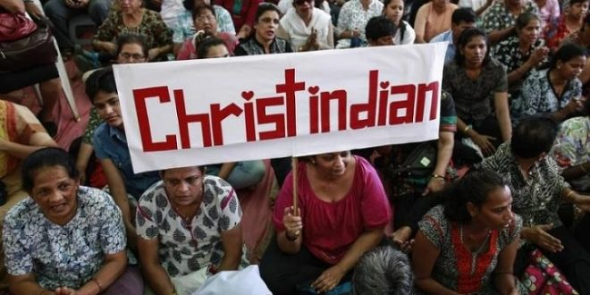 A protester holds a placard during a rally by hundreds of Christians against recent attacks on churches nationwide, in Mumbai February 9, 2015. REUTERS/Danish Siddiqui